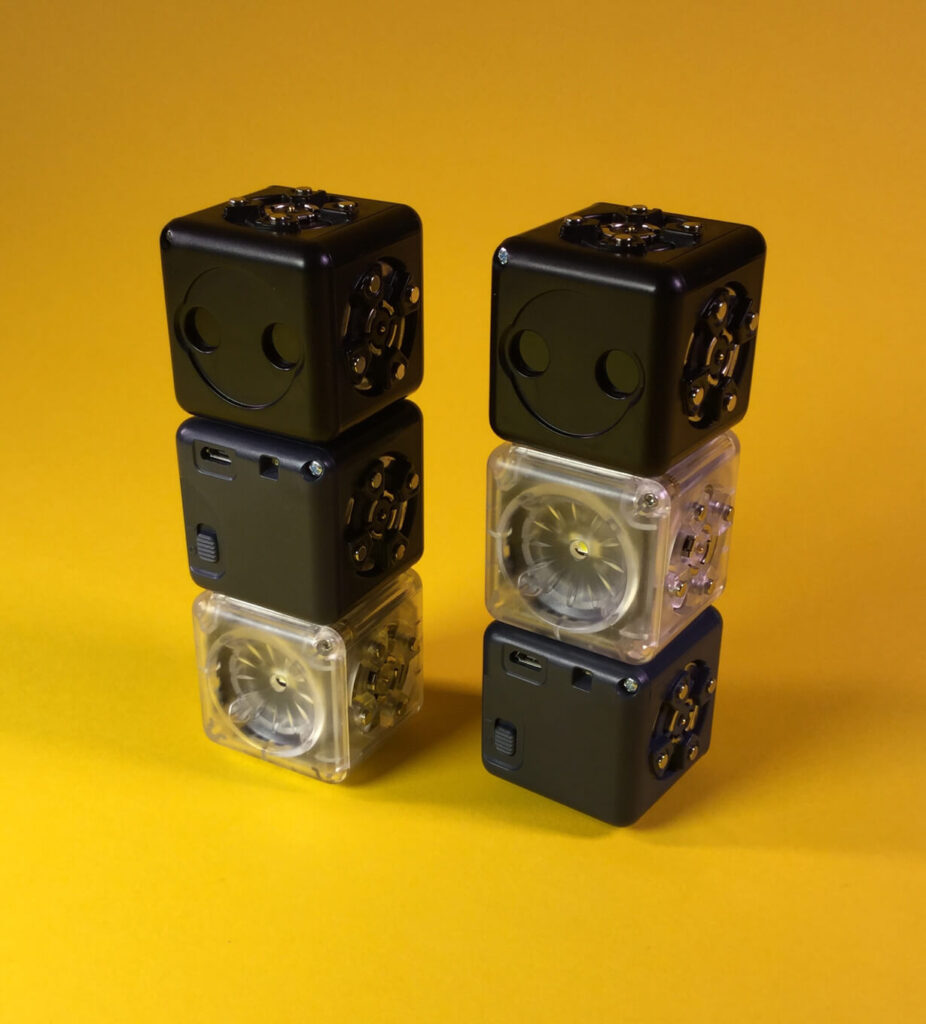 Dimbot robot - Distance Cubelet on top, Battery Cubelet in middle, Flashlight on Bottom.