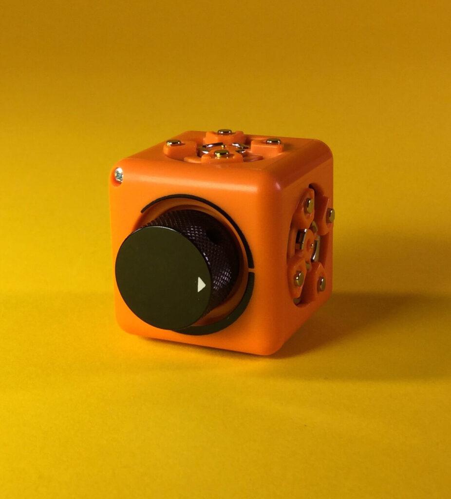 Just a Threshold Cubelet - Orange with a black knob for adjusting behavior (threshold) of block.